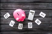 Moneybox In Shape Of Pig, Word Budget And Calculator On Wooden Background Top View poster
