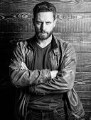 Mature Serious Confident Man With Beard Wooden Background. Confident In His Style. Calm Temper Of Co poster