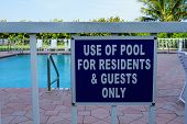 Sign That Tells People The Pool Is For Residents And Guests Only. poster