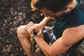 Young Athletic Man Using Fitness Tracker Or Smart Watch Before Run Training Outdoors. Close-up Photo poster