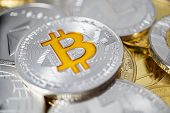 Bitcoin Physical Coin On The Stack Of Other Different Cryptocurrencies. Close-up Photo Of Bitcoin Wi poster