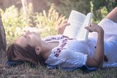 Beautiful Woman Reading Book In Nature In Vacation. Beautiful Woman Reading Book In Nature. Happy Be poster