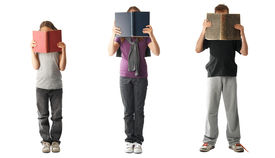 stock photo of little school girl  - Three kids reading books isolated on white - JPG