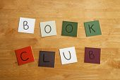 'Book Club' in letters and words on square tiles.