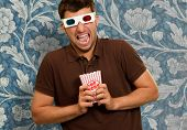 foto of matinee  - Young Man Wearing 3d Glasses On Wallpaper - JPG