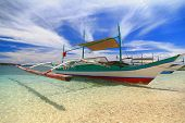 stock photo of boracay  - Traditional Philippines boat shot in Boracay  - JPG