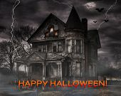 Haunted house with bats, full moon, fog.  - Happy Halloween