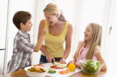 pic of healthy eating girl  - Family Cooking Dinner Eating Food Healthy Preparing Vegetables 10 Year Old 30s Boy Brother Caucasian Child Chopping Color Colour Daughter Domestic Enjoying Feeding Girl Happy Holding Home Horizontal Image Indoors Kitchen Lunch mealmealtime Mid Adult Mothe - JPG