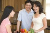 stock photo of healthy eating girl  - Cooking Family Healthy Eating Home Cooking mealmealtime Smiling 12 Year Old 30s 50s Asian Child Color Colour Daughter Enjoying Father Fifties Girl Happy Holding Home Horizontal Image Indoors Inside Kitchen Man Mid Adult Middle Aged Mother Parent Pre - JPG