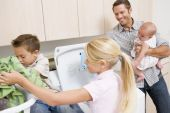 Father And Children Doing Laundry