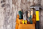 stock photo of carpentry  - set of tools in tool box on a wooden background - JPG