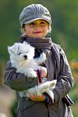stock photo of maltese  - Autumn walk with puppy  - JPG