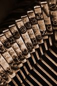 pic of mass media  - Close up of antique typewriter typebars with focus on the  - JPG