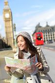 image of westminster bridge  - London tourist woman sightseeing holding map near Big Ben with red double decker bus - JPG