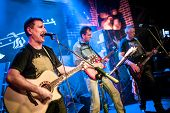 picture of guitarists  - Band performs on stage - JPG