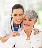 portrait of friendly medical nurse and senior patient