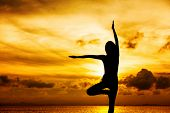 image of natarajasana  - Woman doing yoga during sunset - JPG