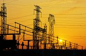 stock photo of transformer  - Impression network at transformer station in sunrise high voltage up to yellow sky - JPG
