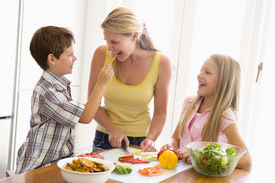 image of healthy eating girl  - Family Cooking Dinner Eating Food Healthy Preparing Vegetables 10 Year Old 30s Boy Brother Caucasian Child Chopping Color Colour Daughter Domestic Enjoying Feeding Girl Happy Holding Home Horizontal Image Indoors Kitchen Lunch mealmealtime Mid Adult Mothe - JPG