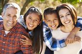stock photo of 11 year old  - Portrait Of Hispanic Family In Countryside - JPG