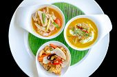 stock photo of gai  - Three thai restaurant food on white dish - JPG