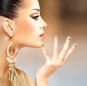 foto of minx  - Profile portrait of the beautiful fashion woman with black makeup and golden manicure - JPG