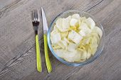 image of endive  - a small bowl of endives with cutlrery - JPG