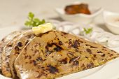 picture of ghee  - Side View Hot delicious paratha with ghee which is made from wheat flour - JPG