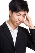Asian businessman feeling headache