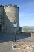 Stirling Castle In Scotland With Wallace Monument In The Distanc poster