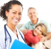 stock photo of medical  - Smiling medical doctor with stethoscope and elderly couple - JPG
