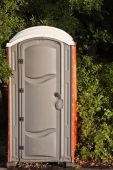 foto of porta-potties  - A clean portable toilet in the park - JPG