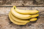 image of bunch bananas  - Bunch of Bananas on Grunge Wooden Background - JPG