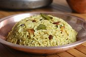 foto of tamarind  - Top view of Puli sadam or Tamarind Rice from South India - JPG