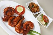 stock photo of tiger prawn  - Top view of Masala Fried Prawns served with vegetable salad - JPG