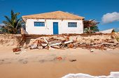 stock photo of rn  - Eroded beach with house Pititinga Natal  - JPG