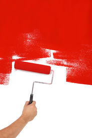 stock photo of knockout  - Painting red with paint roller - JPG