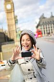 picture of westminster bridge  - Travel tourist in london sightseeing taking selfie photo pictures near Big Ben - JPG