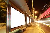 stock photo of bus-shelter  - Blank billboard on bus stop at night - JPG
