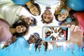 picture of huddle  - Hand holding smartphone showing friends forming huddle - JPG