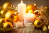stock photo of weihnachten  - Christmas candles background with baubles and ribbons  - JPG