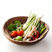 pic of gai  - Ingredients for spicy Thai soup Tom Yam with chili pepper and lemon grass on white wooden background - JPG