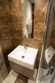 stock photo of bathroom sink  - View of porcelain sink inside small bathroom - JPG