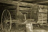 stock photo of horse plowing  - Antique horse drawn plow sits abandoned in a barn - JPG