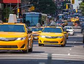 picture of cabs  - Fifth avenue yellow cab taxi 5 th Av New York Manhattan USA - JPG