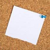 stock photo of reminder  - Blank Paper Reminder Note Pinned to a Cork Memory Bulletin Board as Copy Space for Your Message - JPG