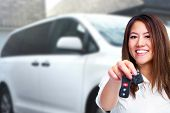 picture of auto garage  - Woman holding a car key - JPG