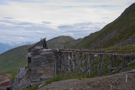 stock photo of hatcher  - Deteriorating trestle bridge with building at Independence Mine - JPG
