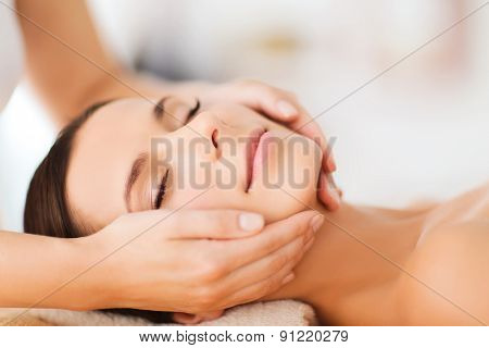 poster of spa, resort, beauty and health concept - beautiful woman in spa salon getting face treatment