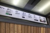 picture of elevator  - Defocus and Blur background of terrace wood and Illuminated signboard in elevator for background - JPG